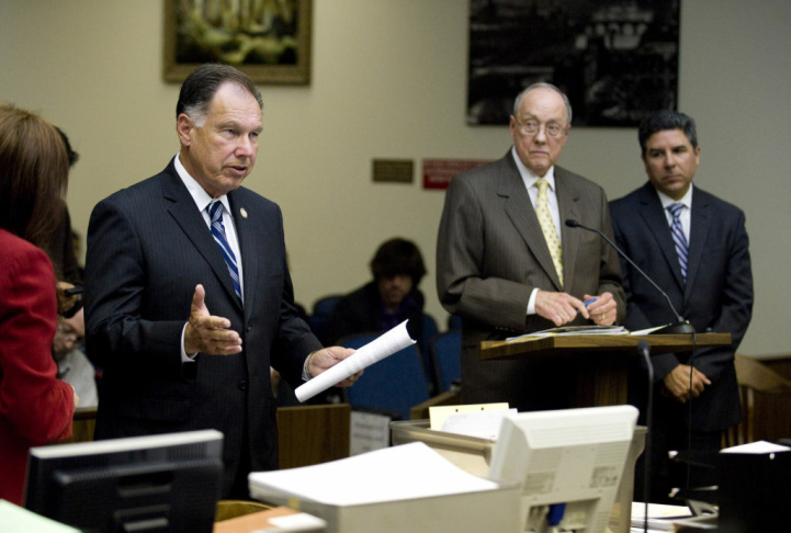 Orange County District Attorney Tony Rackauckas, left, spoke in Orange County Superior Court in Santa Ana, Thursday morning during the arraignment proceedings of Santa Ana City Councilman Carlos Bustamante, right. Bustamante appeared with his attorney James Riddet, center, for arraignment on sexual assault charges involving seven women. The arraignment was continued until July 26.