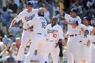 Clayton Kershaw and teammates of the Dodgers celebrate a two run homerun of Matt Kemp for a 2-1 win over the St Louis Cardinals at Dodger Stadium on April 17, 2011.