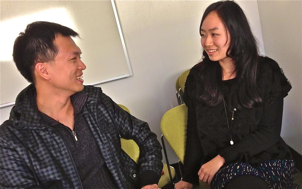 Jiu Hua Zhang, a 23-year-old student from China, chats with fellow English language learner Donald Chung, 28, of Taiwan.