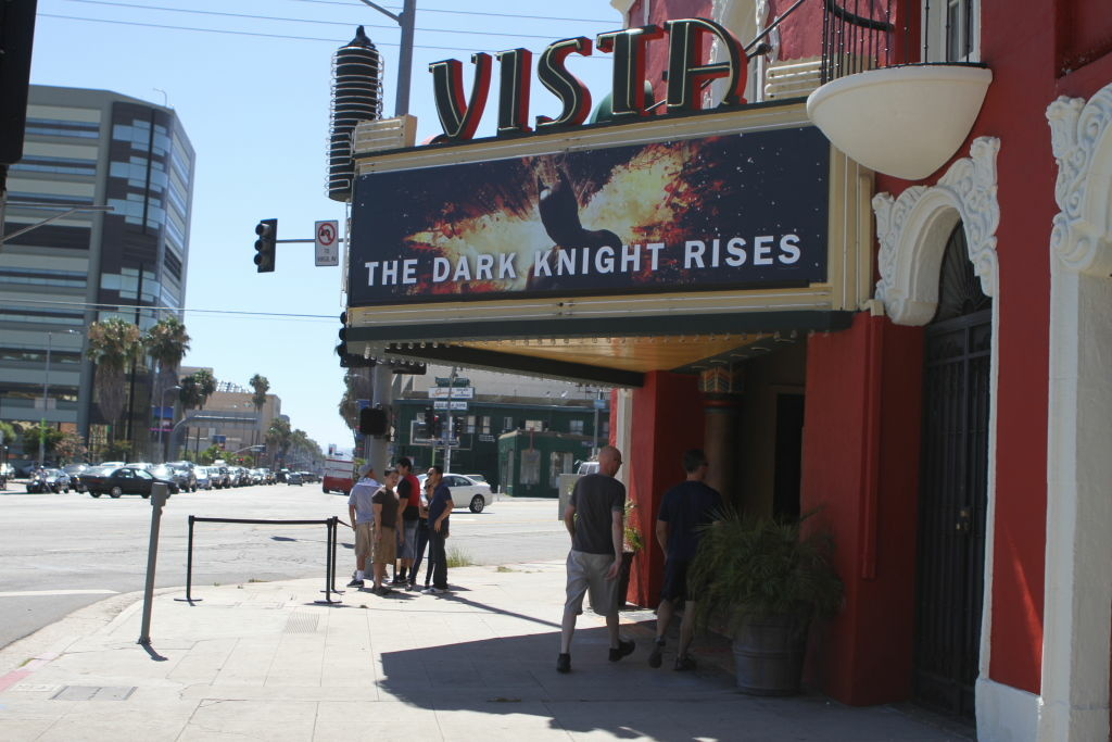 Moviegoers wait outside the Vista Theatre in Hollywood for the next screening of