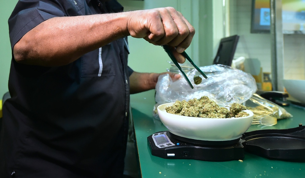 Marijuana is weighed on a scale at Virgil Grant's dispensary in Los Angeles, California on February 8, 2018.