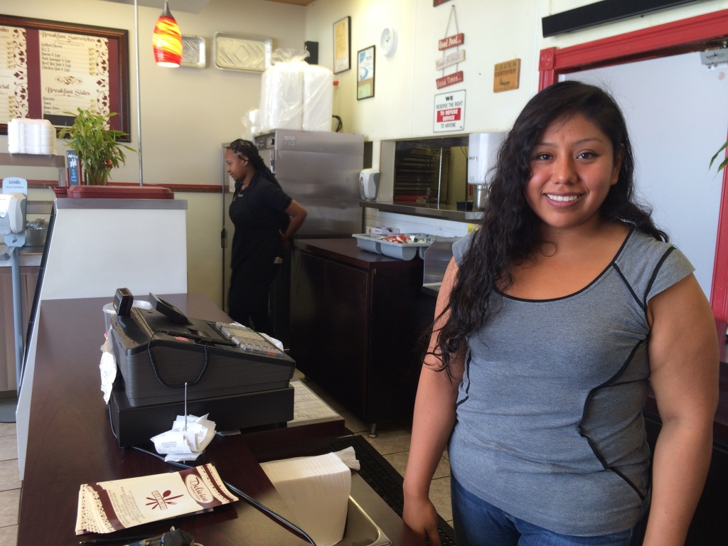 Adriana Cortes is the manager at Delicious Southern Cuisine, on Crenshaw Blvd. Her family opened the restaurant about five years ago and has struggled at times with a chain link fence and other construction directly in front of the store.