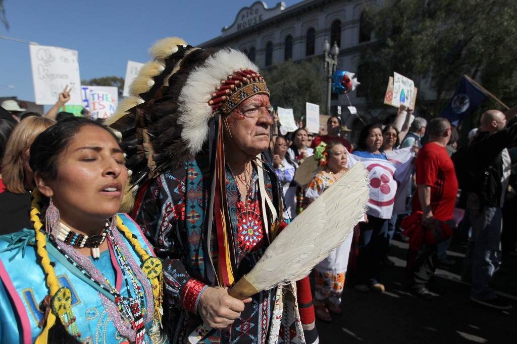 Chief Phil Lane of the Yankton Dakota and Chickasaw First Nations marches with demonstrators to City Hall during the