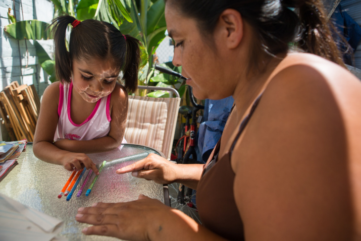 On her day off from school, Simpson spends most of the day tutoring four-year-old Jenaveve Cardenas, who just started the Head Start program this year.