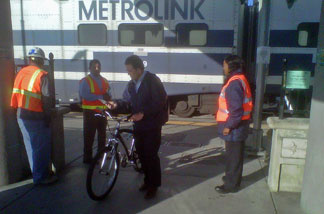 Metrolink workers greeted passengers at the Glendale station this morning to inform them of safety precautions.  The new commuter rail express service begins May 9.