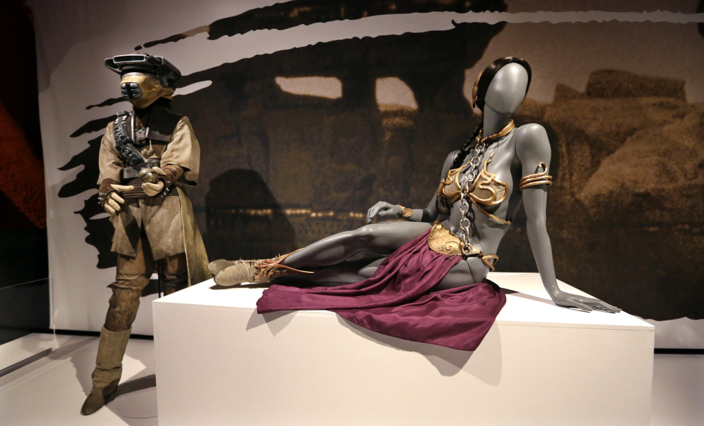 File: In this photo taken Thursday, Jan. 29, 2015, Princess Leia's slave bikini, right, and her Boushh disguise are displayed as part of an exhibit on the costumes of Star Wars at Seattle's EMP Museum.