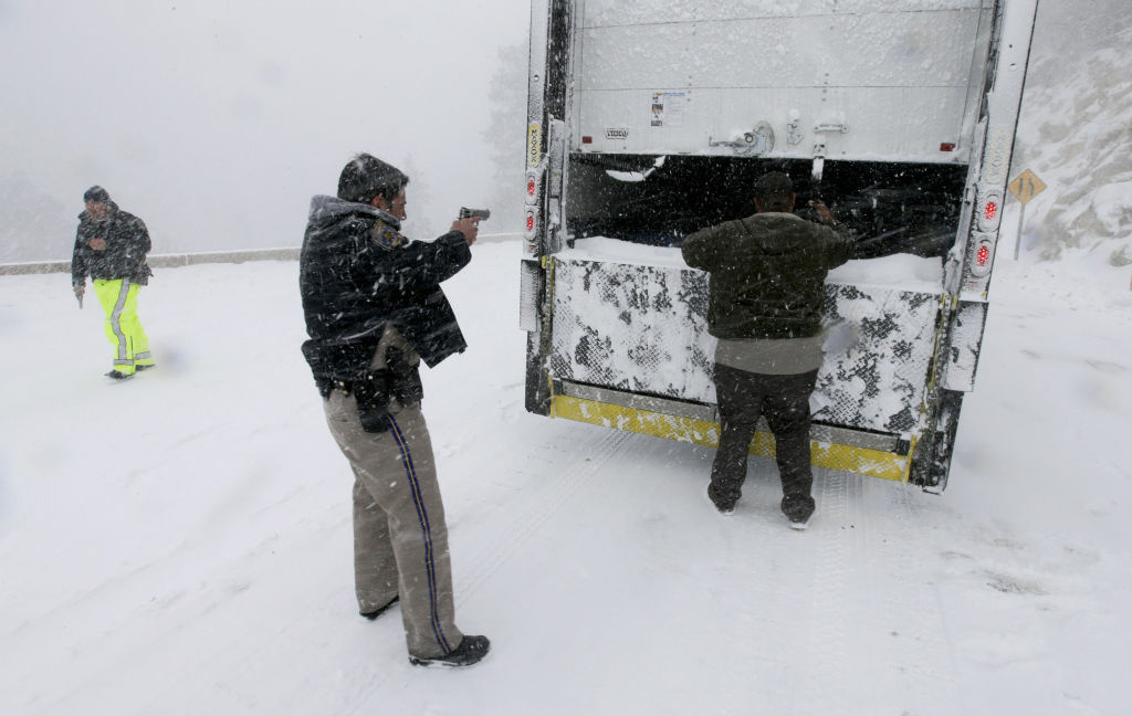 Members on the California Highway Patrol search a truck for Christopher Dorner, a former Los Angeles police officer accused of carrying out a killing spree because he felt he was unfairly fired from his job, Friday, Feb. 8, 2013, in Big Bear Lake, Calif.