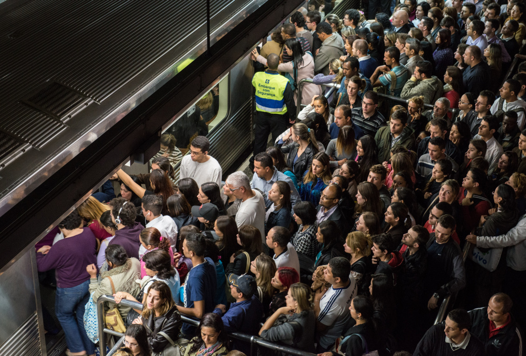 Commuters board a train during the evening hours at Se metro station in Sao Paulo, Brazil, on June 6, 2012.
