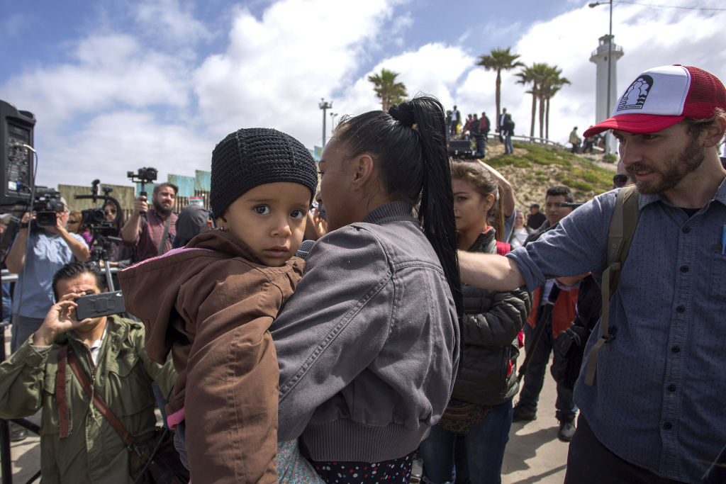 FILE: Members of a caravan of Central American asylum seekers talk to reporters at a rally near the border on April 29, 2018 in Tijuana, Mexico.