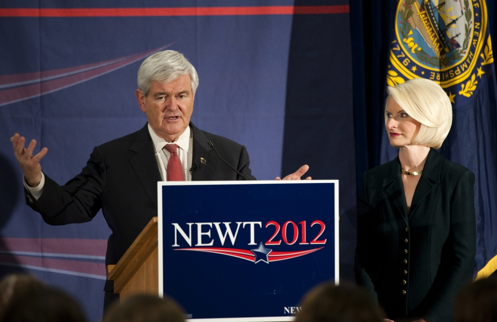 Republican presidential candidate Newt Gingrich talks as his wife Callista listens at a town hall meeting Alvirne High School in Jan. 9, 2012 in Hudson, New Hampshire. Casino magnate Sheldon Adelson donated $5 million over his legal limit to Gingrich's campaign through a SuperPAC called