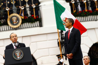 U.S. President Barack Obama (R) listens to Mexican President Felipe Calderon during a welcoming ceremony on the South Lawn of the White House May 19, 2010 in Washington, DC.