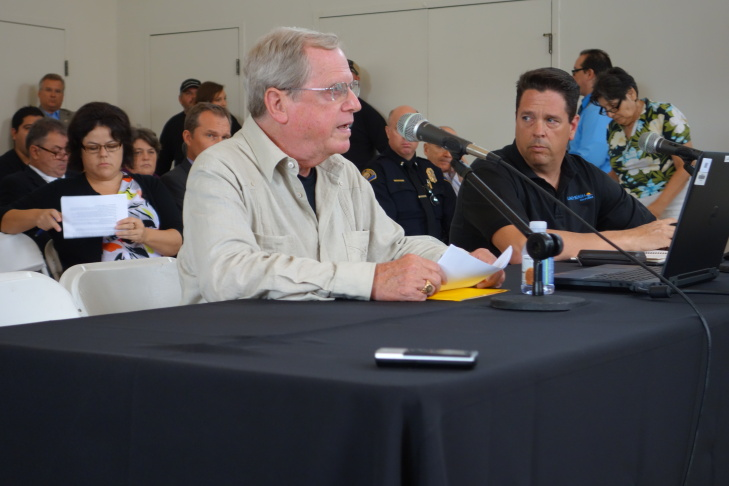 Paul Grigaux a vice president of So. California Edison, describes the July 15 outage that left thousands of Long Beach residents without power. With him at the Long Beach town hall meeting Aug. 22, 2105  is another Edison vice president, Greg Ferree.