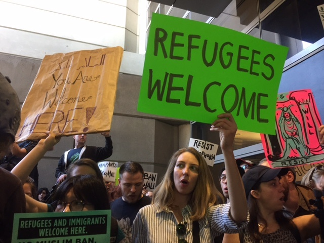 Protesters have gathered at LAX in the arrivals level of Bradley International Terminal.