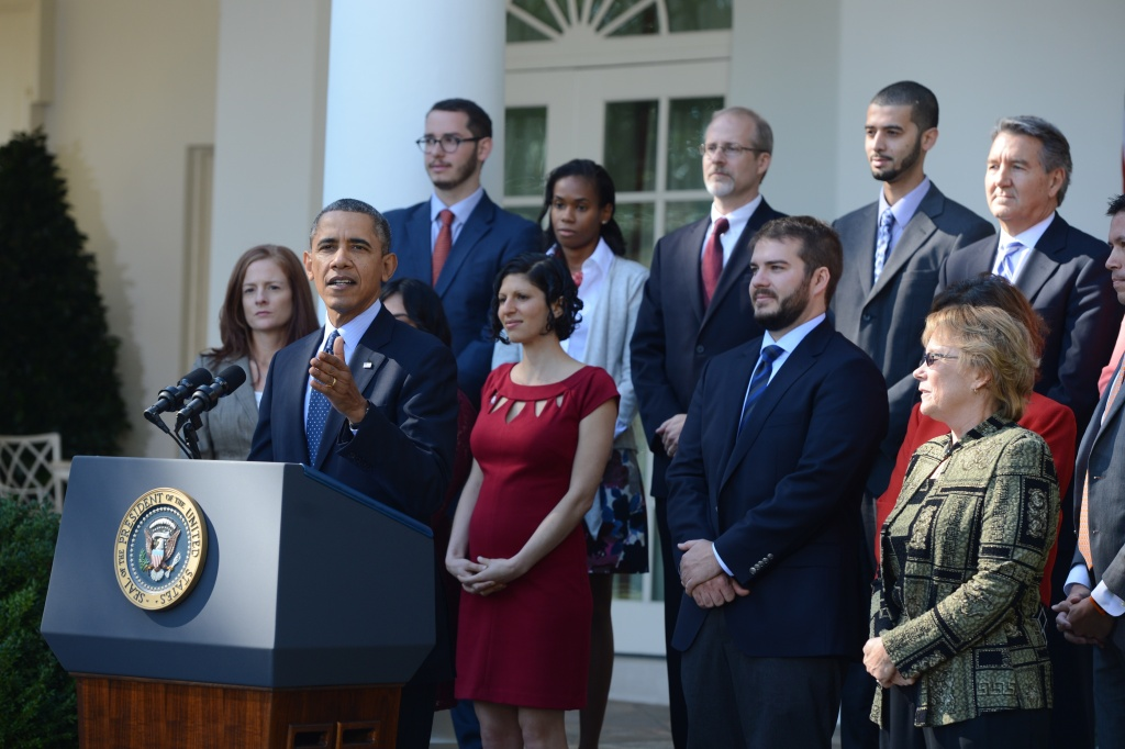 US President Barack Obama speaks about the Affordable Care Act, the new healthcare laws, alongside people who have already benefitted from the legislation, new registrants, small business owners and representatives from partner organizations, in the Rose Garden of the White House in Washington, DC, October 21, 2013.