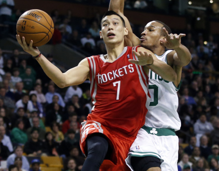 Point guard Jeremy Lin drives to the hoop, helping his old team the Houston Rockets beat the Boston Celtics.