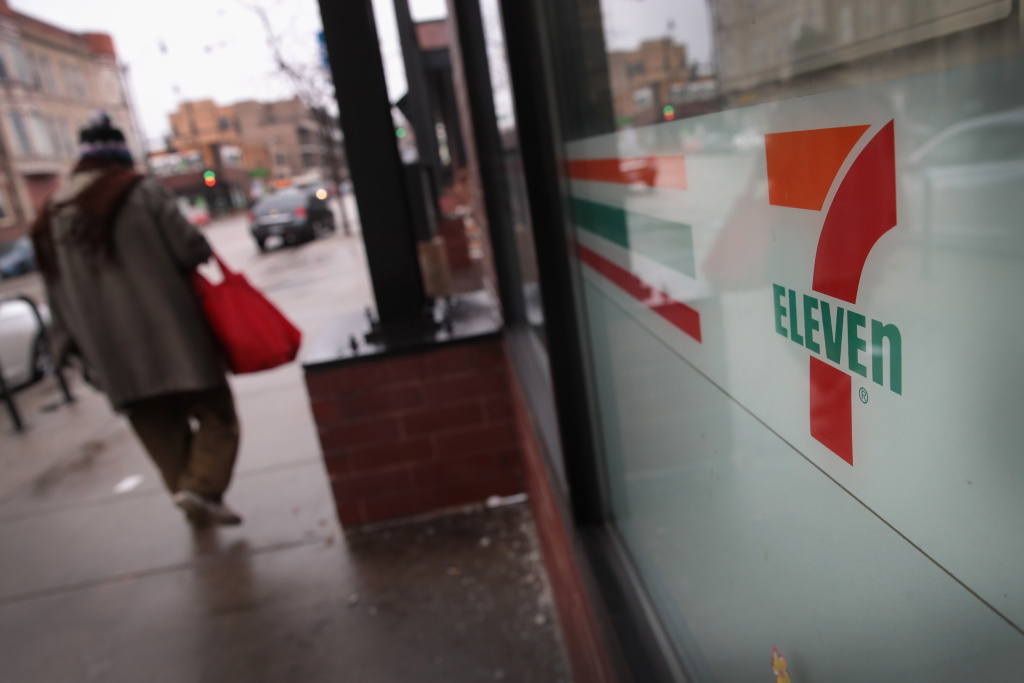 A pedestrian walks past a 7-Eleven store on January 10, 2018 in Chicago, Illinois.