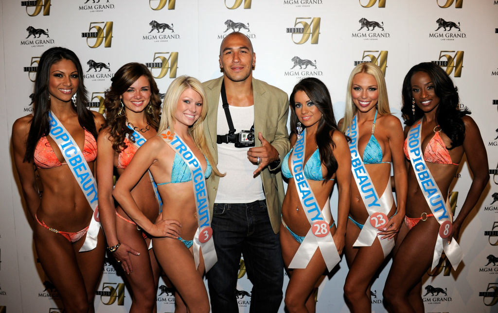 Mixed martial artist Brandon Vera (C) and Tropic Beauty Model Search contestants arrive at a post-fight party for UFC 132.