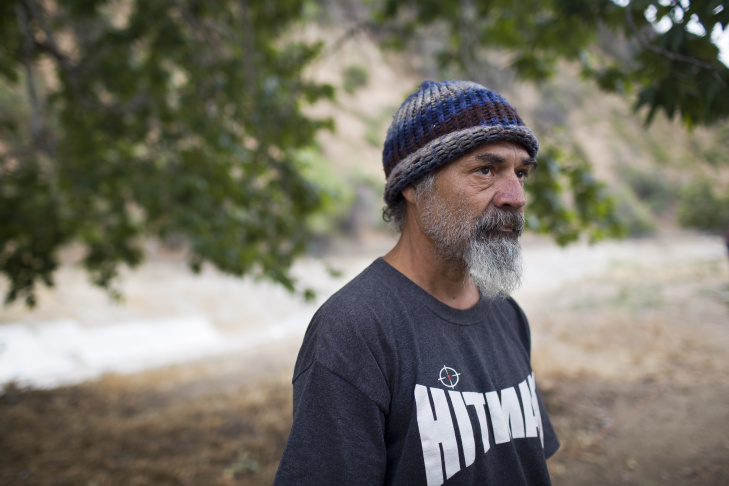 Jesus Torres has lived in the Arroyo Seco riverbed for almost three years. Torres was born in the city of LA during the time of the Watts Riots in 1965. Dozens of encampments have taken root in and around the Arroyo Seco riverbed in the past several years and are now visible along the 110 Freeway.