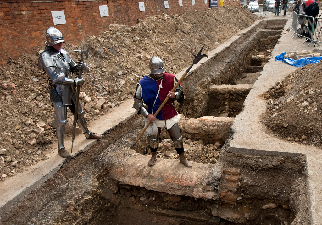 Men dressed as medieval knights pose for pictures in Leicester in central England, on September 12, 2012, at a site where a skeleton that researchers believe could be British medieval king Richard III was found.