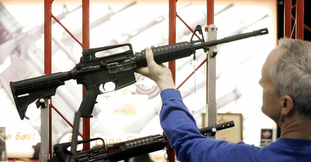 Bill Saxler of Milwaukee holds a Bushmaster rifle 19 May, 2006, during the 135th National Rifle Association (NRA) Annual Convention in Milwaukee, Wisconsin. The show runs through 21 May.