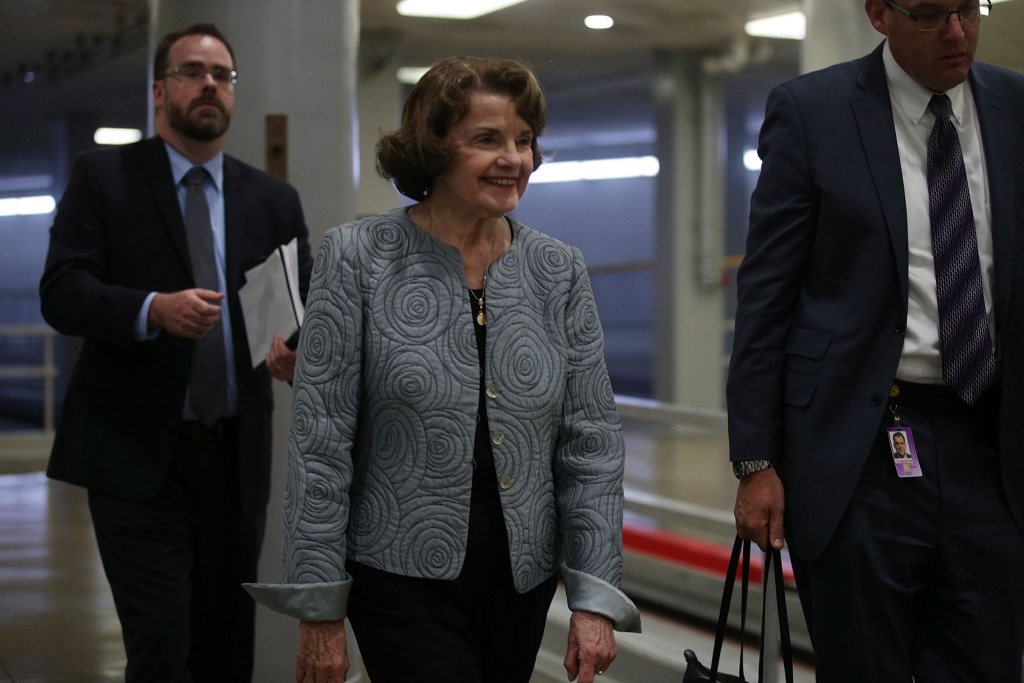 WASHINGTON, DC - SEPTEMBER 05:  U.S. Sen. Dianne Feinstein (D-CA) (2nd L) arrives for a vote at the Capitol September 5, 2017 in Washington, DC. Congress is back from summer recess with a heavy legislative agenda in front of them.  (Photo by Alex Wong/Getty Images)