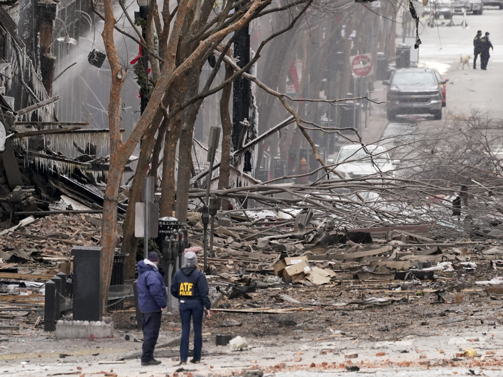 Emergency personnel work near the scene of an explosion in downtown Nashville on Friday. Law enforcement is looking into who and how many may have been involved.