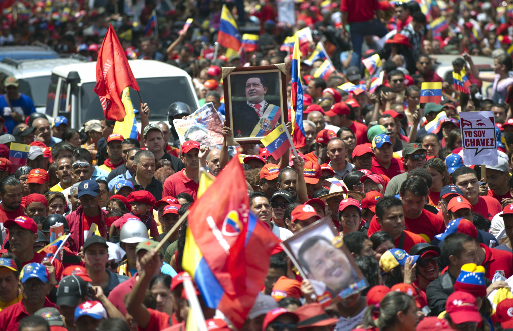 The flag-draped coffin of Venezuelan leader Hugo Chavez was borne through throngs of weeping supporters today as it made its way to the Military Academy in Caracas.