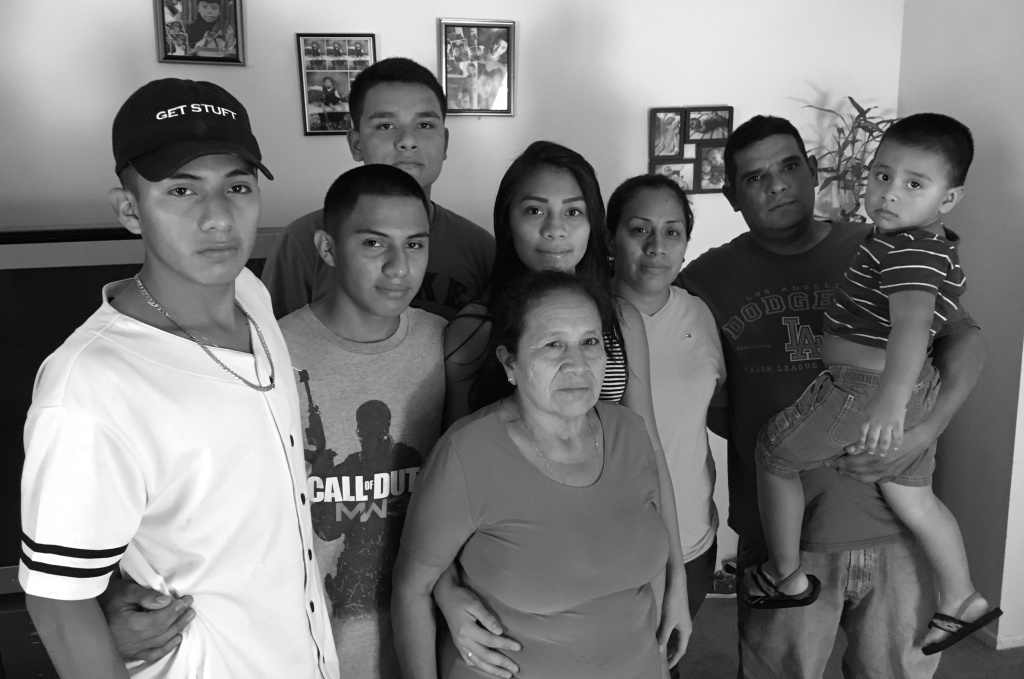 The extended Hernández-Gonzalez family in their home in La Quinta. The two boys, Alejandro, far left, and Luis, second from left, were both granted asylum in 2016 after fleeing violence in El Salvador.