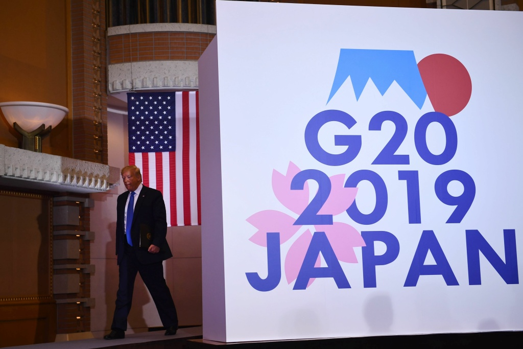 US President Donald Trump arrives for a press conference on the sidelines of the G20 Summit in Osaka on June 29, 2019.