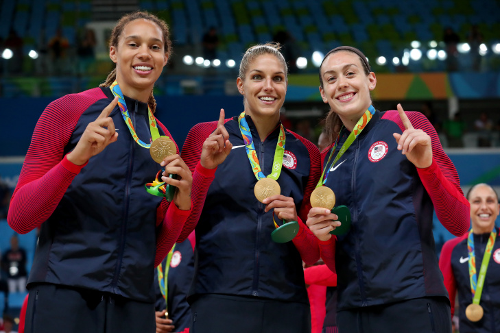 (L to R) Gold Medalists Gabrielle Douglas, Simone Biles, Lauren Hernandez, Madison Kocian and Alexandra Raisman of the United States pose for photographs on the podium at the medal ceremony for the Artistic Gymnastics Women's Team on Day 4 of the Rio 2016 Olympic Games at the Rio Olympic Arena on August 9, 2016 in Rio de Janeiro, Brazil.