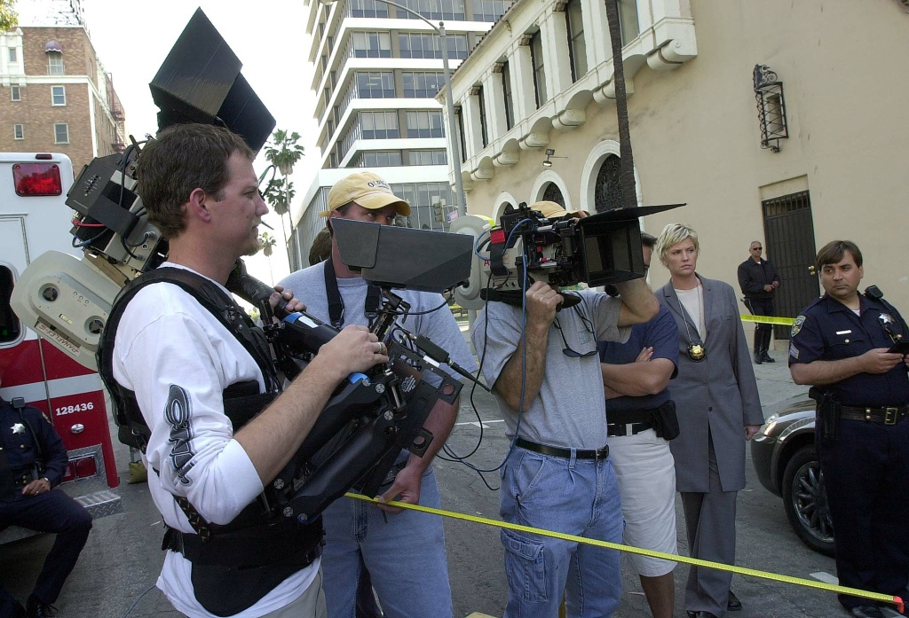 Ron Baldwin and Eyal Gordin prepare to film on the set of Paramount Pictures' television drama series 'The Division' in downtown Los Angeles, CA 30 April 2001.