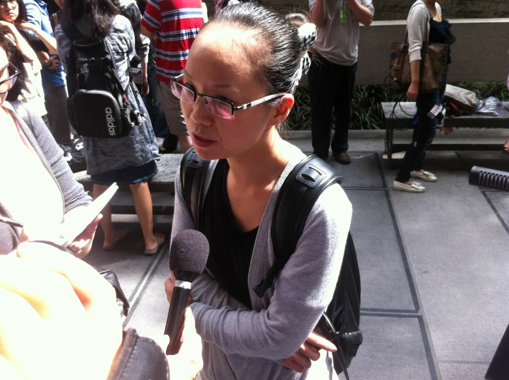 USC student Julia Liu speaks with reporters outside L.A.'s downtown courthouse. Liu was a close friend of Ming Qu, who was shot to death April 11, 2012.