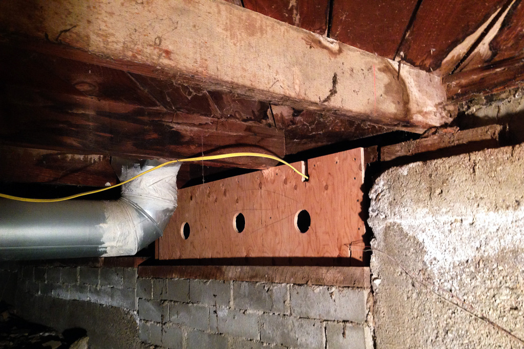The plywood is used to support the cripple wall after it is bolted to the frame. Plywood is remarkably strong and flexible, making it an ideal reinforcement for seismic retrofits.