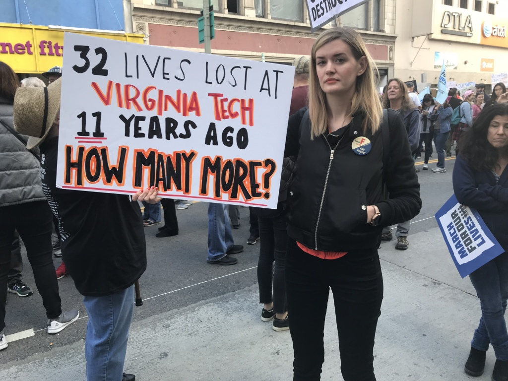Karin Innocenti holds her sign at the March for Our Lives rally in downtown Los Angeles.