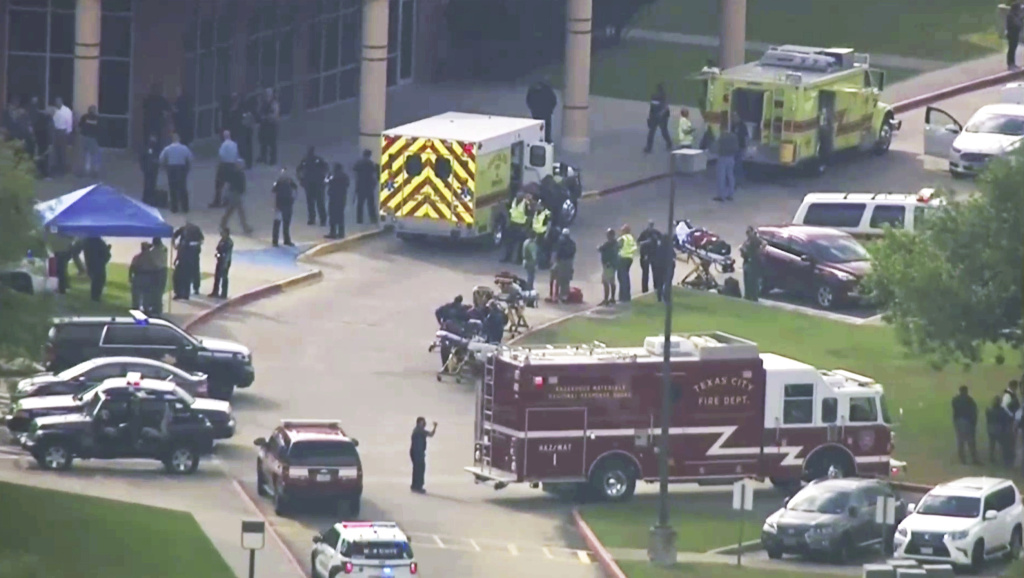 In this image taken from video emergency personnel and law enforcement officers respond to a high school near Houston after an active shooter was reported on campus, Friday, May 18, 2018, in Santa Fe, Texas.