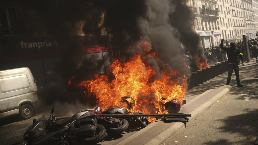 A set of motorbikes are set on fire during a yellow vest demonstration in Paris on Saturday. Protesters are marching to remind the government that rebuilding the fire-ravaged Notre Dame Cathedral isn't the only problem the nation needs to solve. (AP Photo/Francisco Seco)