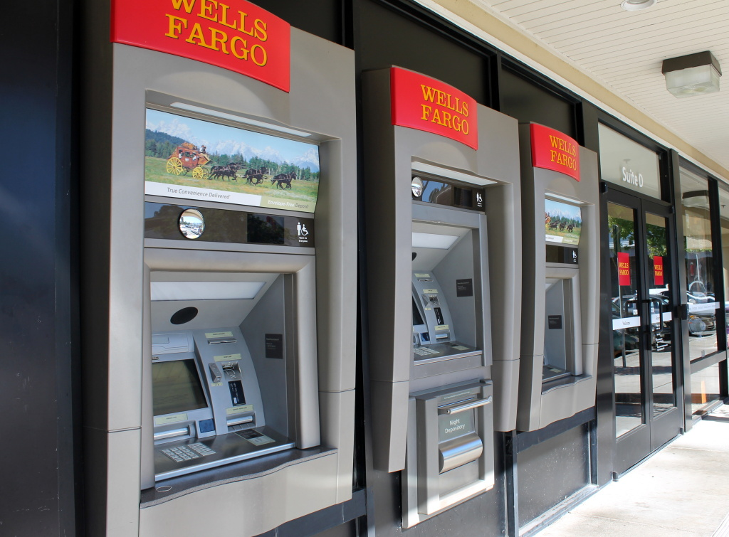 a line of ATMs at a Wells Fargo branch