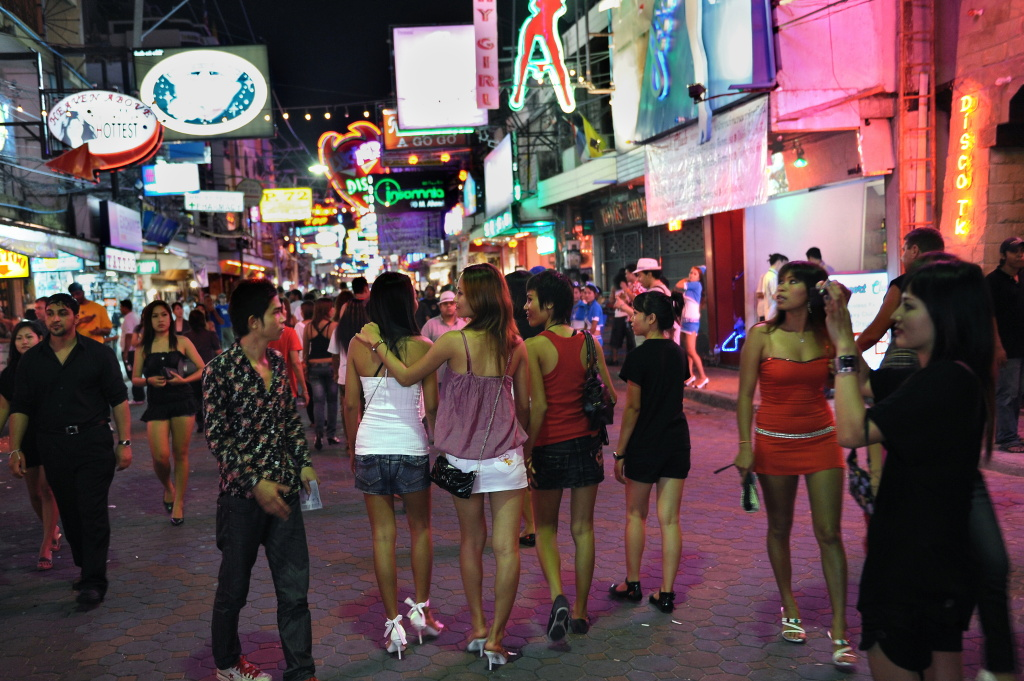 Men and women walk in the red light district in Pattaya on April 10, 2009. The US State Department last month put Thailand on its human trafficking watchlist, accusing it of not doing enough to combat trafficking.