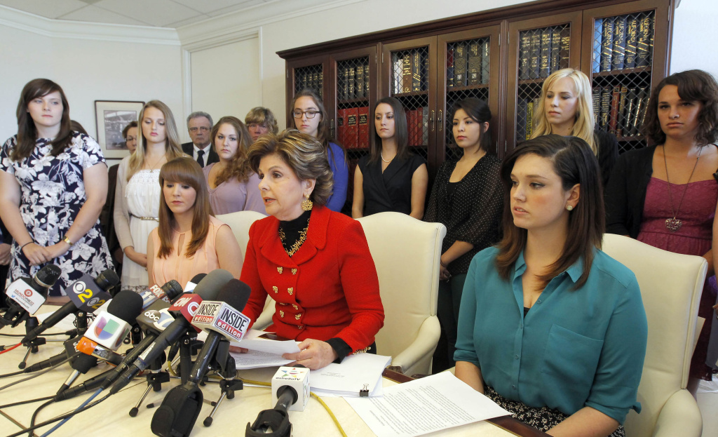 Attorney Gloria Allred is shown speaking with students and alumni who allege Occidental College administrators violated federal standards for dealing with their rape, sexual assault or retaliation claims, Thursday April 18, 2013 in Los Angeles. Officials at University of Southern California and Occidental College later said they had underreported the number of campus sexual assaults in recent years — a potential violation of federal law that could lead to hundreds of thousands of dollars in penalties.