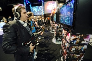People play 'Guitar Hero' on Oct. 27, 2010 in Paris during the first edition of the 'Paris Games week' event.