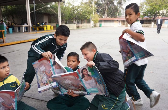 Students engage in a class project at the Escuela 20 Noviembre school in Tijuana, Mexico.
