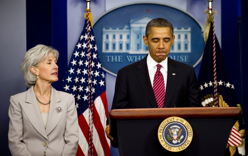 US President Barack Obama stands with Health and Human Services Secretary Kathleen Sebelius (L) as he announces that religious employers will not be mandated to offer free contraceptive coverage for workers at the White house in Washington, DC, February 10, 2012.