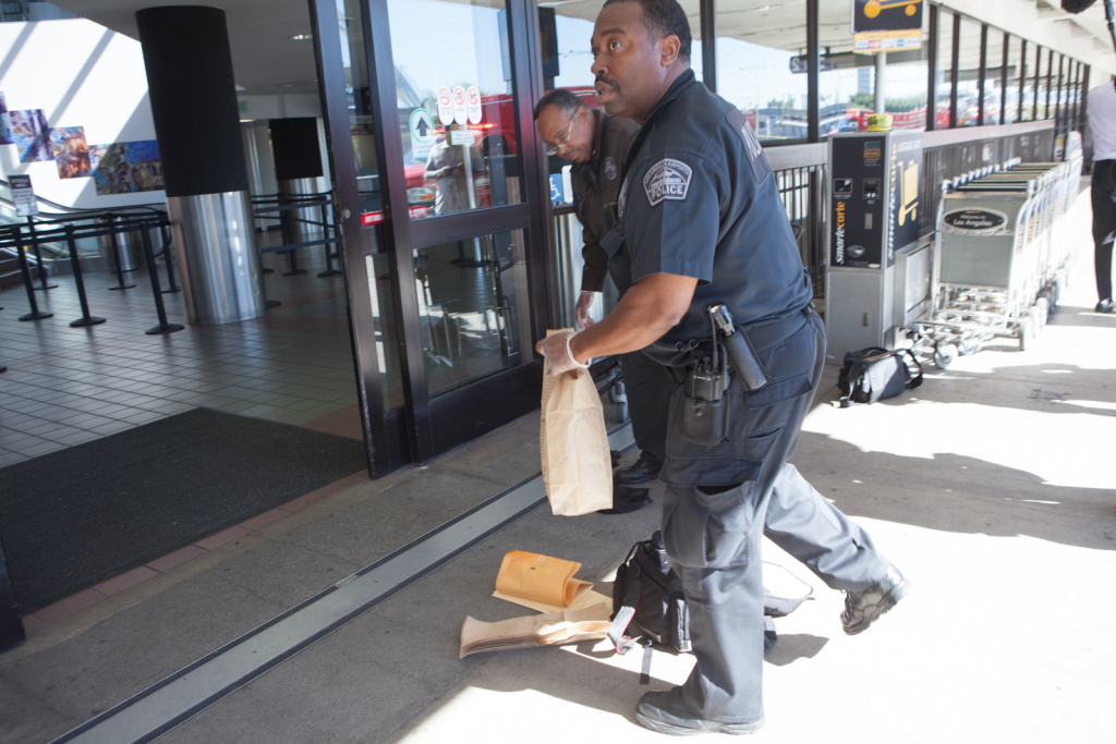 LAX police officers gather evidence outside an LAX terminal following a shooting on November 1st, 2013.
