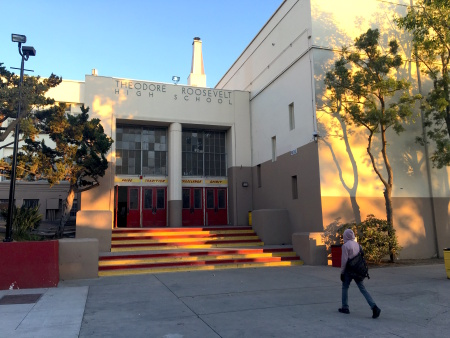 "A student walks toward an entrance of the historic ""R Building"" on the campus of L.A. Unified's Roosevelt High School in Boyle Heights."