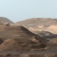 Mars's massive Mount Sharp may have formed billions of years ago as water carried sand and silt into the center of a large crater.