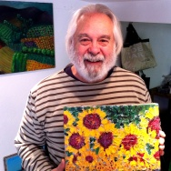 Frank Romero with one of his French paintings, in his home in the South of France.