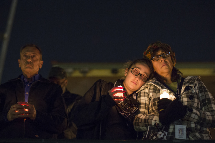 Jennifer and husband Roy Trules cry as the names of victims are read aloud during a moment of silence concluding a vigil at San Manuel Stadium in San Bernardino on Thursday night, Dec. 3, 2015. Both were friends with 26-year-old Aurora Godoy of San Jacinto. Roy Trules first met Godoy more than three years ago when they both worked for the San Bernardino County Registrar of Voters.