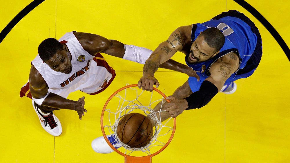 Tyson Chandler dunks against Chris Bosh in Game Six of the NBA finals on June 12. The late-start 2011 NBA season begins Sunday.
