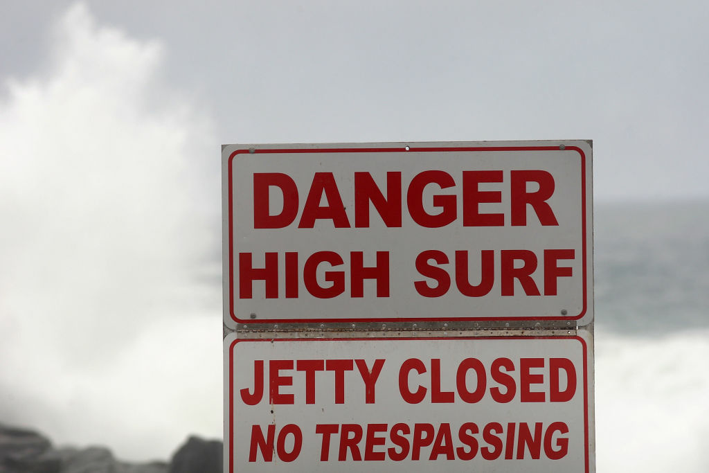 A sign advising high surf in in Newport Beach, California, on July 24, 2009. Hurricane Rosa created big waves for surfers, but little rain.