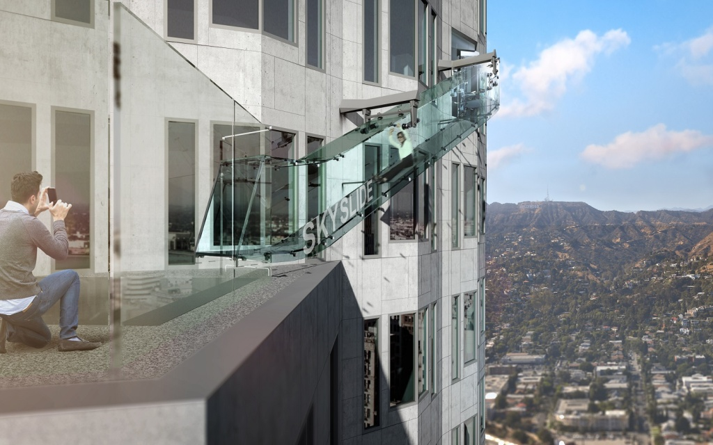SkySlide is a part of a SkySpace, an observation deck opening this June at the US Bank Building. Suspended 1,000 feet above street level, it chutes visitors from the 70th to the 69th floor